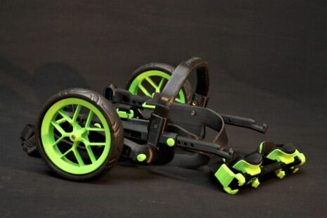 folding wheels, cart for handicapped dogs, green accessories on wheelchair for dogs